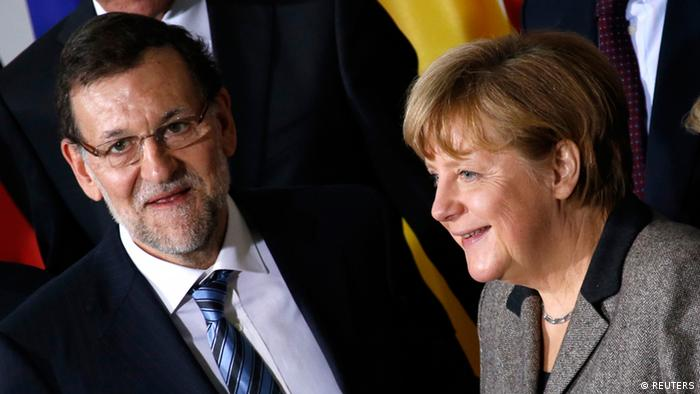 German Chancellor Angela Merkel and Spanish Prime Minister Mariano Rajoy (L) pose for a group picture with members of their cabinets at the Chancellery in Berlin February 4, 2013. REUTERS/Fabrizio Bensch (GERMANY - Tags: POLITICS)