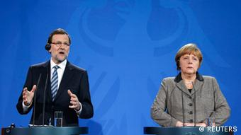 German Chancellor Angela Merkel (R) and Spanish Prime Minister Mariano Rajoy address a news conference at the Chancellery in Berlin February 4, 2013. REUTERS/Fabrizio Bensch (GERMANY - Tags: POLITICS)