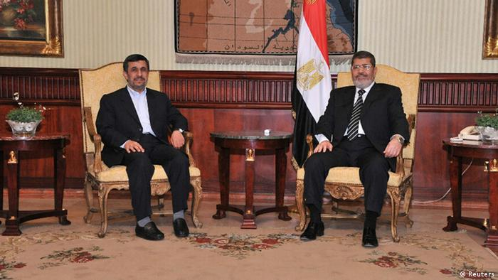 Egyptian President Mohamed Mursi (R), meets with Iran's President Mahmoud Ahmadinejad after he arrives at International Airport in Cairo in this photo provided by the Egyptian Presidency on February 5, 2013. Ahmadinejad arrived in Egypt on Tuesday on the first trip by an Iranian head of state since the 1979 revolution, underlining the thaw in relations since Egyptians elected an Islamist head of state. REUTERS/Egyptian Presidency/Handout (EGYPT - Tags: POLITICS) ATTENTION EDITORS - THIS IMAGE WAS PROVIDED BY A THIRD PARTY. FOR EDITORIAL USE ONLY. NOT FOR SALE FOR MARKETING OR ADVERTISING CAMPAIGNS. THIS PICTURE IS DISTRIBUTED EXACTLY AS RECEIVED BY REUTERS, AS A SERVICE TO CLIENTS