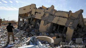 GettyImages 160772088 A man searches on February 5, 2013 in the ruins of a building destroyed by French air strikes in Douentza.The town was retaken by French and Malian troops in January. AFP PHOTO / PASCAL GUYOT (Photo credit should read PASCAL GUYOT/AFP/Getty Images)