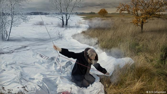 A woman sewing a white blanket of snow onto the ground. Montage by Erik Johansson