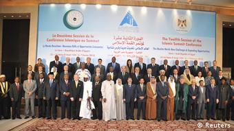Egyptian President Mohamed Mursi (first row, 12th L) stands with other leaders of Islamic nations for a group photo before the opening of the Organisation of Islamic Cooperation (OIC) summit in Cairo February 6, 2013. Leaders of Islamic nations called for a negotiated end to Syria's civil war at a summit in Cairo that began on Wednesday, thrusting Egypt's new Islamist president to centre stage amid political and economic turbulence at home. REUTERS/Egyptian Presidency/Handout (EGYPT - Tags: POLITICS) ATTENTION EDITORS - THIS IMAGE WAS PROVIDED BY A THIRD PARTY. FOR EDITORIAL USE ONLY. NOT FOR SALE FOR MARKETING OR ADVERTISING CAMPAIGNS. THIS PICTURE IS DISTRIBUTED EXACTLY AS RECEIVED BY REUTERS, AS A SERVICE TO CLIENTS