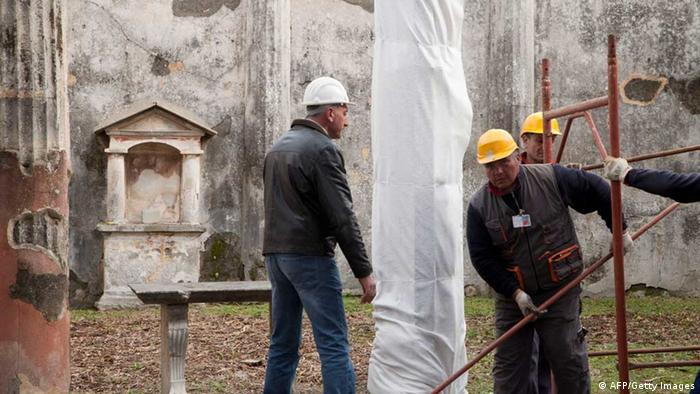 Restorers work on Pompeii. Photo: CARLO HERMANN/AFP