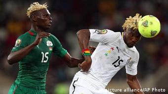 Ghana's Isaac Vorsah, right, defends against Burkina Faso's Aristide Bance, left, during their African Cup of Nations semifinal soccer match at Mbombela Stadium in Nelspruit, South Africa, Wednesday Feb. 6, 2013. (AP Photo/Themba Hadebe)