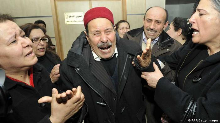 The father of assassinated Tunisian opposition leader and outspoken government critic Chokri Belaid mourns after his killing on February 6, 2013, at a clinic in Tunis. Belaid was gunned down outside his home (Photo: FETHI BELAID/AFP/Getty Images)
