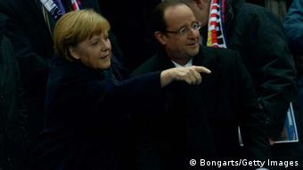 German chancellor Angela Merkel and french president Francois Hollande attend the international friendly match between France and Germany at Stade de France on February 6, 2013 in Paris, France. (Photo: Dennis Grombkowski / Bongarts / Getty Images)