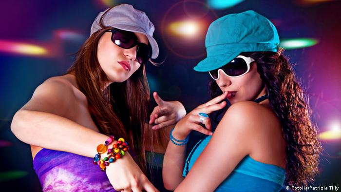 Teenagers with sunglasses and caps in a club