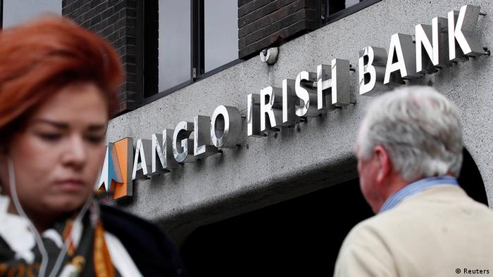 Pedestrians are seen walking past a branch of the Anglo Irish Bank in Dublin REUTERS/Cathal McNaughton/Files (IRELAND - Tags: BUSINESS POLITICS)