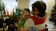 US Paar russisches Kind Adoption Russland Moskau Down Syndrom Behinderung Gendefekt Gesundheit Krankheit