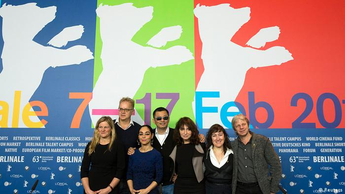 The Berlinale jury poses before a news conference at the 63rd Berlinale International Film Festival in Berlin February 7, 2013. Pictured are L-R: Ellen Kuras, Tim Robbins, Shirin Neshat, Wong Kar Wai, Susanne Bier, Athina Rachel Tsangari and Andreas Dresen. The 2013 Berlin film festival kicks off on Thursday with The Grandmaster, a martial arts epic from Hong Kong director Wong Kar Wai who is also presiding over this year's jury. REUTERS/Thomas Peter (GERMANY - Tags: ENTERTAINMENT)
