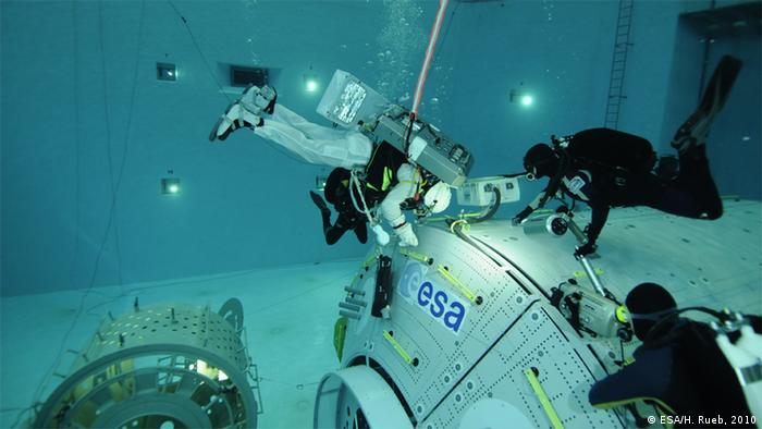 ESA astronaut Luca Parmitano, from Italy, during EVA training at ESA's Neutral Buoyancy Facility at the European Astronaut Centre, in Cologne, Germany, 2 September 2010. This course teaches ESA astronauts basic Extravehicular Activity (EVA, or 'spacewalk') concepts and skills, such as tethering to the International Space Station, the use of special EVA tools, communicating with an EVA crewmate and with the control room and how to keep full situational awareness in a complex and challenging environment.