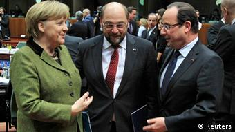 Germany's Chancellor Angela Merkel (L), European Parliament President Martin Schulz (C) and France's President Francois Hollande (R) attend an European Union leaders summit meeting to discuss the European Union's long-term budget in Brussels February 7, 2013. European Union leaders begin two days of talks on a long-term budget on Thursday, with efforts to refocus spending on growth likely to be thwarted by demands for farm subsidies as pressure to reach a deal grows. REUTERS/Yves Herman (BELGIUM - Tags: POLITICS BUSINESS)