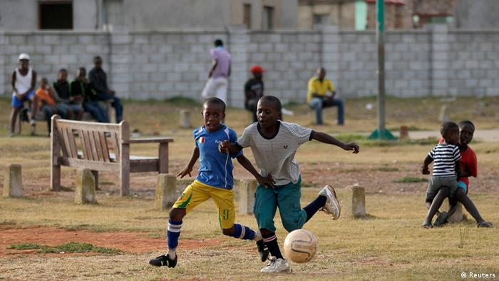 Young boys play soccer at a township in Port Elizabeth (Siphiwe Sibeko/REUTERS)