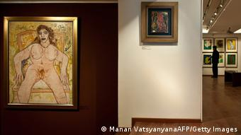 Indian artist F.N.Souza's painting (L) is displayed at an art exhibition The Naked and the Nude at an art gallery in New Delhi (Photo: MANAN VATSYAYANA/AFP/Getty Images)
