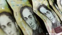 Venezuelan currency is seen in this November 30, 2011 image taken in Caracas, Venezuela. AFP PHOTO/ Leo RAMIREZ (Photo credit should read LEO RAMIREZ/AFP/Getty Images)
