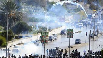 Thousands of Tunisians demonstrating (AP Photo/Hassene Dridi)