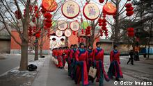 BEIJING, CHINA - FEBRUARY 09: Chinese paramilitary police officers dressed as Qing Dynasty servants march before a re-enactment of an ancient ceremony of Qing Dynasty emperors praying for good harvest and fortune during the opening ceremony of the Spring Festival Temple Fair at the Temple of Earth park on February 9, 2013 in Beijing, China. The Chinese Lunar New Year of Snake also known as the Spring Festival, which is based on the Lunisolar Chinese calendar, is celebrated from the first day of the first month of the lunar year and ends with Lantern Festival on the Fifteenth day. (Photo by Feng Li/Getty Images)
