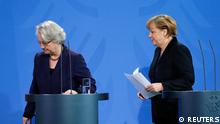 German Chancellor Angela Merkel (R) and Education Minister Annette Schavan leave after a statement to the media in Berlin February 9, 2013. Germany's education minister resigned on Saturday after being stripped of her doctorate over plagiarism charges, an embarrassment for her close confidante Chancellor Angela Merkel who is campaigning to win a third term in office this year. REUTERS/Tobias Schwarz (GERMANY - Tags: POLITICS)