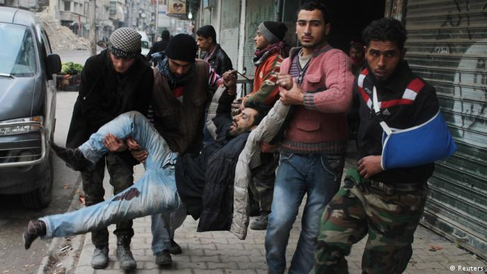 Free Syrian Army fighters and civilians transport a wounded man into a hospital in Aleppo's al-Shaar district after what activists said was from a ground-to ground missile attack by forces loyal to Syria's President Bashar al-Assad at Aleppo's Hanano district, February 8, 2013. REUTERS/Saad AbuBrahim (SYRIA - Tags: POLITICS CIVIL UNREST TPX IMAGES OF THE DAY)