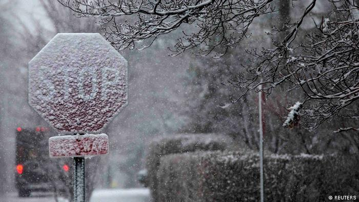 A stop sign is seen covered in snow in Pelham, New York (Photo via REUTERS)