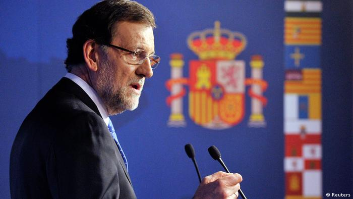 Spain's Prime Minister Mariano Rajoy speaks during a news conference at the end of an European Union (Photo via REUTERS)