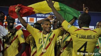 Malian players celebrate with their bronze medal at the end of the 2013 African Cup of Nations third place final football match Mali vs Ghana, on February 9, 2013 in Port Elizabeth. Mali won 3 to 1. AFP PHOTO / ISSOUF SANOGO (Photo credit should read ISSOUF SANOGO/AFP/Getty Images)