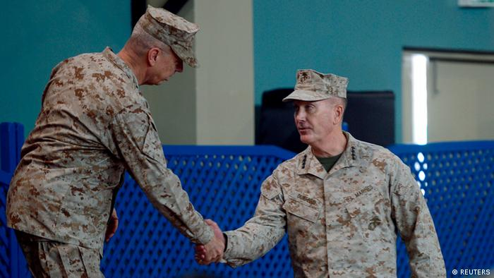 U.S. Marine General Joseph Dunford (R) shakes hand with outgoing NATO commander U.S. Marine General John Allen during a change of command ceremony at the ISAF headquarters in Kabul February 10, 2013. Dunford, expected to oversee the withdrawal of most foreign troops from Afghanistan by the end of next year, took control of the NATO-led mission on Sunday, in an elaborate ceremony which emphasised the country's sovereignty. REUTERS/Massoud Hossaini/Pool (AFGHANISTAN - Tags: POLITICS MILITARY)