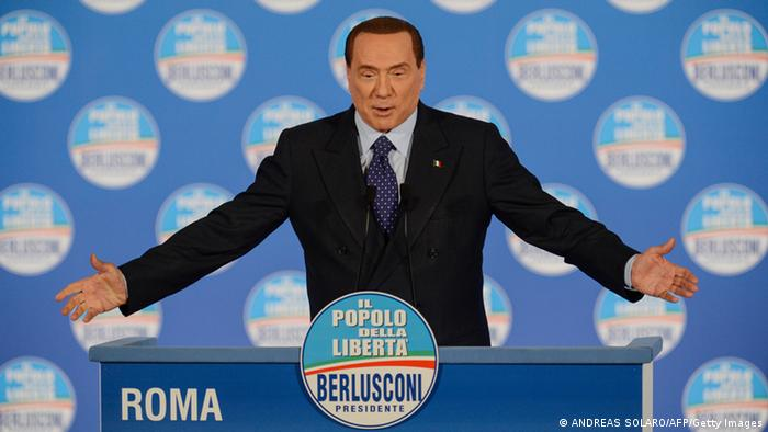 Italy's former Prime minister Silvio Berlusconi delivers a speech during a rally of his party Il Popolo della liberta (People of the Freedom - PDL) in Rome, on February 7, 2013. AFP PHOTO / ANDREAS SOLARO (Photo credit should read ANDREAS SOLARO/AFP/Getty Images)
