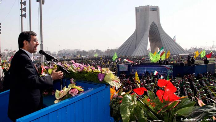 epa03576750 Iranian president Mahmoud Ahmadinejad (L) addresses a crowd gathering at the Azadi (Freedom) square for a ceremony marking the 34th anniversary of the 1979 Islamic revolution in Tehran, Iran, 10 February 2013. On the occasion of the 34th anniversary of the Islamic revolution Iranian President Mahmoud Ahmadinejad once again proclaimed that the country would make no concessions with the West over its nuclear programmes. EPA/ABEDIN TAHERKENAREH