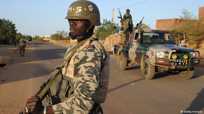 Malian soldiers patrol on February 10, 2013 in northern city of Gao.A PASCAL GUYOT/AFP/Getty Images)