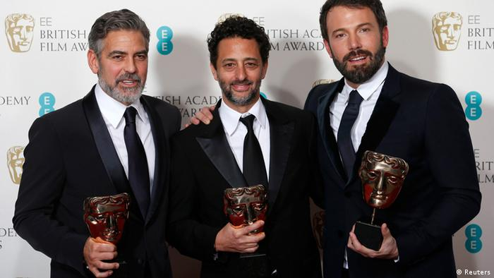 Ben Affleck (R), George Clooney (L) and Grant Heslvov celebrate after winning the Award for Best Film for the movie Argo at the British Academy of Film and Arts (BAFTA) awards ceremony at the Royal Opera House in London February 10, 2013. REUTERS/Suzanne Plunkett (BRITAIN - Tags: ENTERTAINMENT) (BAFTA-WINNERS)