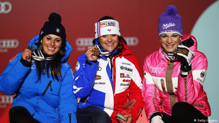GettyImages 161367437 SCHLADMING, AUSTRIA - FEBRUARY 10: Race winner Marion Rolland (C) of France celebrates at the medal ceremony with second placed Nadia Fanchini (L) of Italy and third placed Maria Hoefl-Riesch (R) of Germany following the Women's Downhill during the Alpine FIS Ski World Championships on February 10, 2013 in Schladming, Austria. (Photo by Clive Rose/Getty Images)