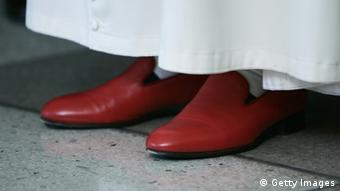 The red shoes of Pope Benedict XVI are seen on April 18, 2008 at United Nations headquarters in New York. Pope Benedict XVI on Friday used his landmark visit to UN headquarters Friday to pay a glowing tribute to the organization's staff, particularly those who have sacrificed their lives in the line of duty. AFP PHOTO/Stan HONDA (Photo credit should read STAN HONDA/AFP/Getty Images)