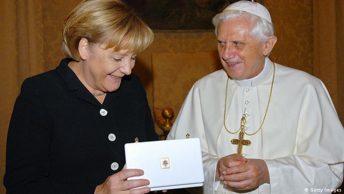 FILES - Picture taken on August 28, 2006 shows German Chancellor Angela Merkel meeting Pope Benedict XVI in Castegandolfo outside Rome in Italy. Pope Benedict XVI and German Chancellor Angela Merkel spoke on the telephone to try to put a row over a Holocaust-denying bishop behind them, the two said in a joint statement on February 8, 2009. AFP PHOTO POOL / ARTURO MARI / OSSERVATORE ROMANO (Photo credit should read ARTURO MARI / OSSERVATORE ROMANO/AFP/Getty Images)