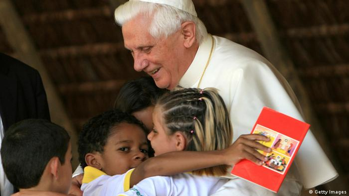 GUARANTIGUETA, BRAZIL - MAY 12: Pope Benedict XVI embraces children during a visit at the Fazenda da Esperanca, a facility for recovering drug addicts, May 12, 2007 in Guaratingueta, Brazil. The pope is on a five-day visit to Brazil. (Photo by Franco Origlia/Getty Images)