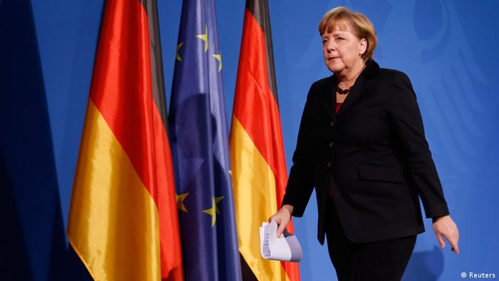 German Chancellor Angela Merkel leaves after making a statement in the Chancellery in Berlin, February 11, 2013 (Photo: REUTERS/ Fabrizio Bensch)