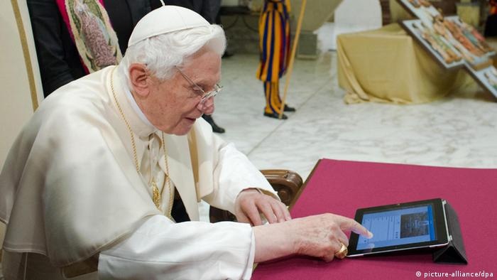 A handout photo provided by the Vatican newspaper 'L'Osservatore Romano' on 12 December 2012 shows Pope Benedict XVI (L) for the first time publishing a post on the social platform service Twitter at the end of a general audience in the Paolo VI Hall at the Vatican, Vatican City, 12 December 2012.