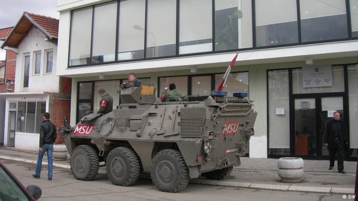 A KFOR tank stationed outside the city center in Mitrovica