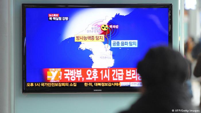 GettyImages 161501149 South Korean passengers watch TV news reporting North Korea's apparent nuclear test, at the Seoul train station on February 12, 2013. North Korea's apparent nuclear test had an explosive yield of between six and seven kilotons, South Korea's defence ministry said, revising its earlier estimate of 10 kilotons or more. Ministry spokesman Kim Min-Seok said seismic monitors had detected a tremor with a 4.9 magnitude emanating from the North's nuclear test site. AFP PHOTO / KIM JAE-HWAN (Photo credit should read KIM JAE-HWAN/AFP/Getty Images)