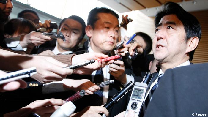 Japan's Prime Minister Shinzo Abe (R) speaks to media after attending a meeting of Security Council of Japan at his official residence in Tokyo February 12, 2013 after reports of North Korea's possible nuclear test. (Photo: REUTERS/Issei Kato)