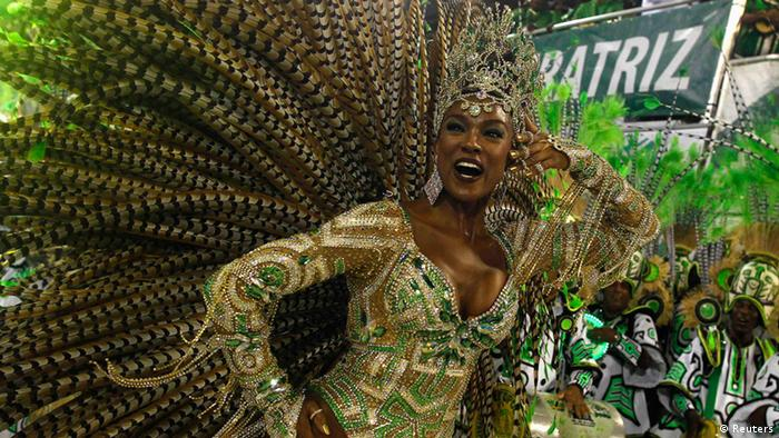 Drum queen Cris Vianna from Imperatriz Leopoldinense samba school participates during the annual carnival parade in Rio de Janeiro's Sambadrome, February 12, 2013. REUTERS/Pilar Olivares (BRAZIL - Tags: SOCIETY)