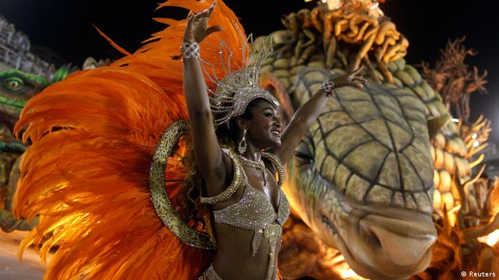 A reveller from the Vila Isabel samba school participates in the annual Carnival parade in Rio de Janeiro's Sambadrome February 12, 2013. REUTERS/Pilar Olivares (BRAZIL - Tags: SOCIETY)