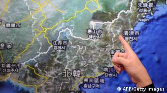 CGettyImages 161502978 Chen Kuo-chang, a senior technical specialist from Taiwan's Seismology Center points towards a North Korean map at the location that North Korea staged a nuclear test, at the Central Weather Bureau in Taipei on February 12, 2013. North Korea staged an apparent nuclear test of six to seven kilotons in a striking act of defiance that, if confirmed, is sure to trigger global condemnation from enemies and allies alike. AFP PHOTO / Sam Yeh (Photo credit should read SAM YEH/AFP/Getty Images)
