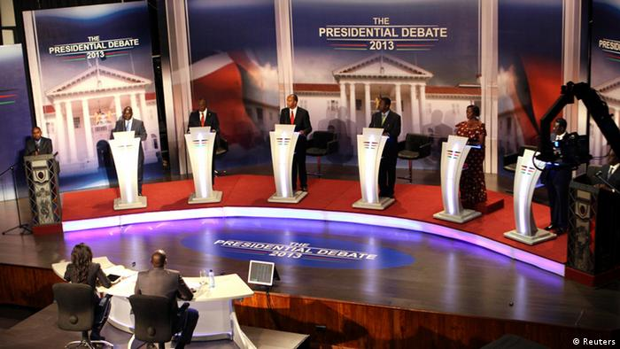 The eight Kenyan presidential aspirants Mohammed Dida, James Ole Kiyiapi, Uhuru Kenyatta, Peter Kenneth, Musalia Mudavadi, Martha Karua, Kenyan Prime Minister Raila Odinga and Paul Muite (L-R) face off in the first ever presidential debate at Brookhouse School in Kenya's capital Nairobi February 11, 2013. The presidential television debate - the first ever held in the country - failed to produce a clear winner, but gave an early taste of what is expected to be a highly charged contest to run East Africa's economic powerhouse. Picture taken February 11, 2013. REUTERS/Stringer (KENYA - Tags: ELECTIONS POLITICS)