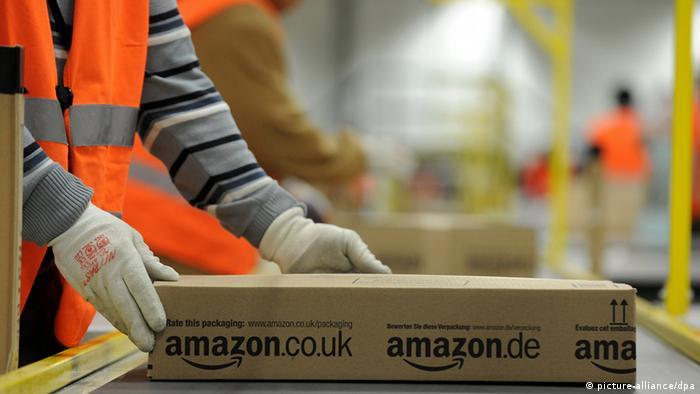 Worker handling package at Amazon logistics center in Pforzheim