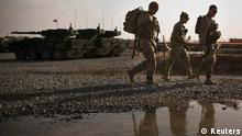 U.S. Army soldiers with Charlie Company, 36th Infantry Regiment, 1st Armored Division walk past a puddle at Command Outpost Pa'in Kalay, in Maiwand District, Kandahar Province, February 3, 2013. REUTERS/Andrew Burton (AFGHANISTAN - Tags: MILITARY CONFLICT)