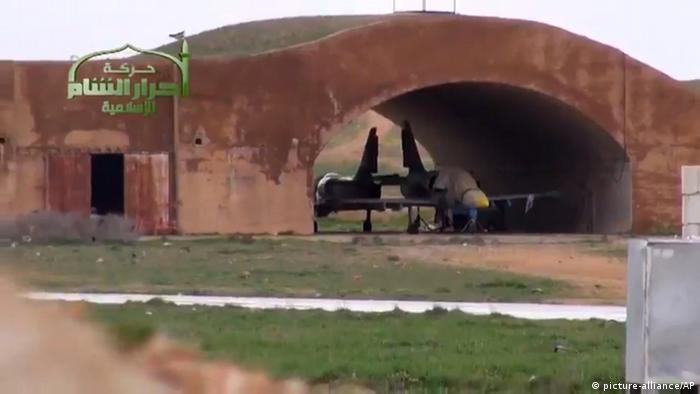 This image taken from video obtained from Ugarit News, which has been authenticated based on its contents and other AP reporting, shows a Syrian fighter jet in a hangar after rebels captured Jarrah airfield in Aleppo province, Tuesday, Feb. 12, 2013. (Photo: AP Photo/Ugarit News via AP video)