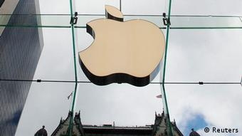 The Apple logo hangs in a glass enclosure above the Fifth Avenue Apple Store in New York in this September 20, 2012 file photo. Apple Inc. is experimenting with the design of a device similar to a wristwatch that would operate on the same platform as the iPhone and would be made with curved glass, the New York Times reported on February 10, 2013. REUTERS/Lucas Jackson/Files (UNITED STATES - Tags: BUSINESS SCIENCE TECHNOLOGY LOGO TPX IMAGES OF THE DAY)