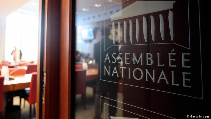 The logo of French National Assembly is pictured at the entrance of the law commitee room on January 30, 2013 at the National Assembly in Paris. AFP PHOTO / JACQUES DEMARTHON (Photo credit should read JACQUES DEMARTHON/AFP/Getty Images)