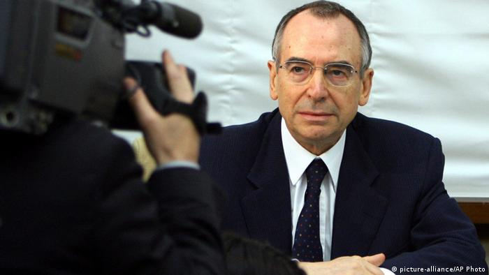 This July 19, 2006 file photo shows then head of SISMI Italian Military intelligence Nicolo Pollari looking at cameraman prior to an Italian Senate Defense Commission, in Rome. (Photo: AP Photo/Alessandra Tarantino)